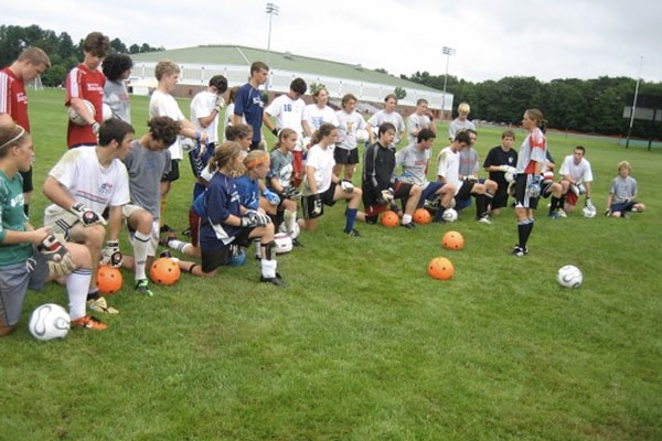 Lisa Cole teaching a group of goalkeepers at SoccerPlus camp.